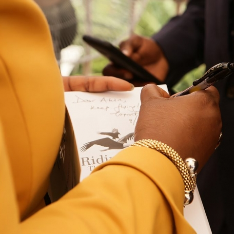 """Toyin Sanni Autographing a copy of her New Book """"Riding The Eagle"""""""